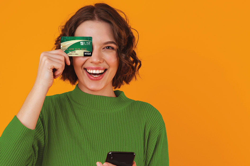 woman holding usf fcu credit card